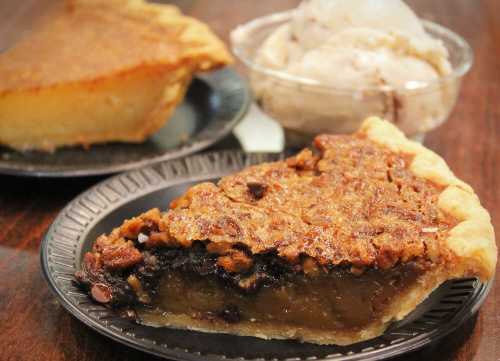 Chocolate Pecan Pie at Homeade Pie & Ice Cream Kitchen in Louisville, KY. Derby Pie is a legally protected trademark, but you can find Chocolate Pecan Horse Racing Themed Seasonal Pie and its equivalents all over Louisville. It's a famous - and quirky - food from Louisville, Kentucky!