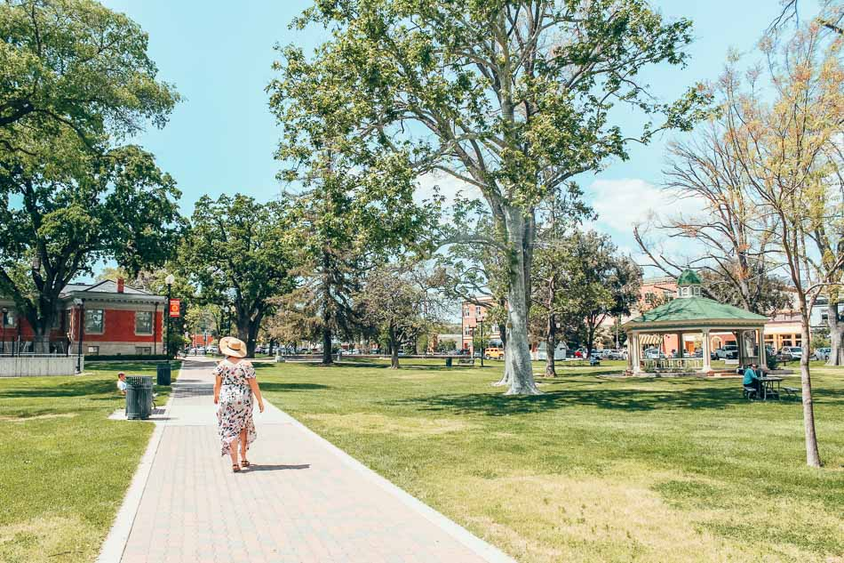 Strolling along the downtown plaza in Paso Robles, California.
