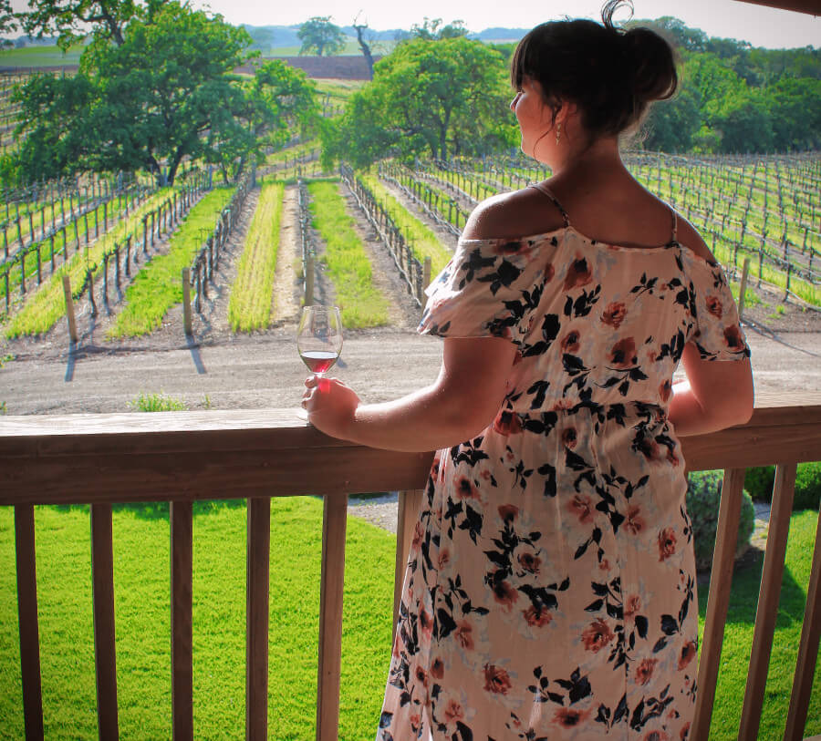 Gazing out as the sun sets over the vineyards at Zenaida Cellars, one of the few Paso Robles, California wineries with lodging. We highly recommend you stay in a winery hotel if you can afford the splurge!
