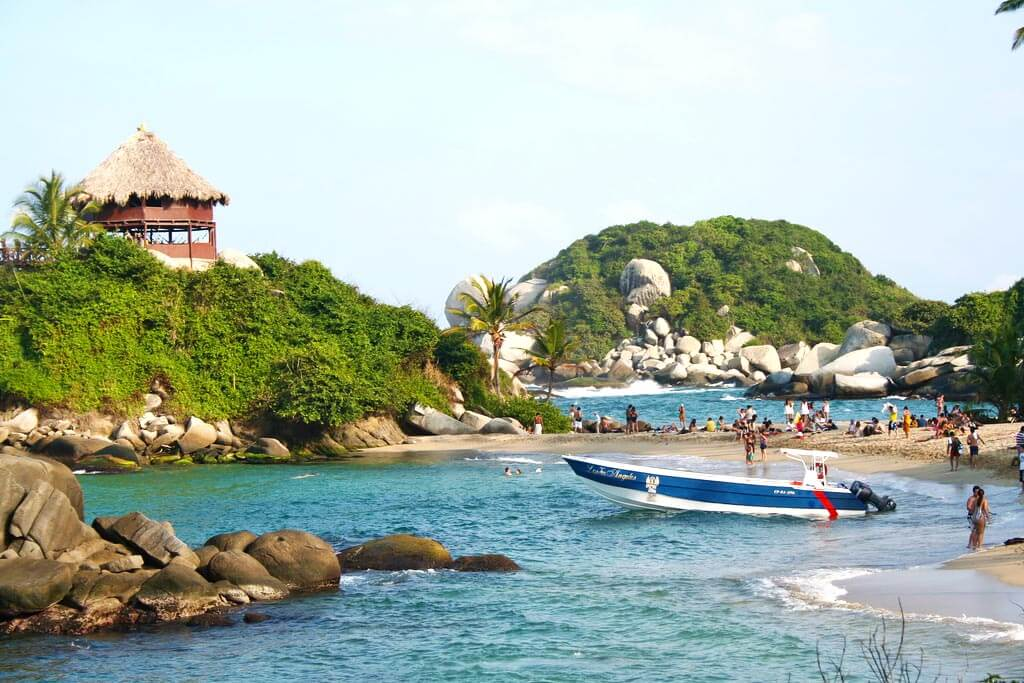 Parque Tayrona, Colombia: an idyllic beach tucked into the jungle. You have to walk 2 hours to get there, but it's SO worth it! Read more at our ultimate Colombia backpacking itinerary.