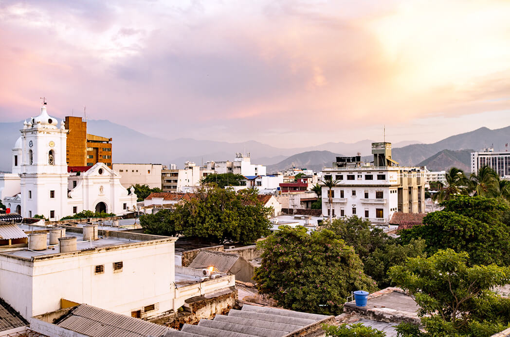 Watching the sun set over Santa Marta, Colombia, with the Sierra Nevada mountains in the background. Santa Marta is one of those places you'll end up going when backpacking Colombia, even if you don't quite mean to.