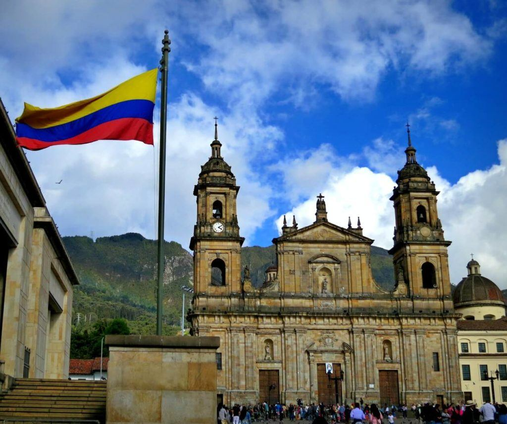 The Colombian flag flying high in Bogota, Colombia. Everything you need to know about what to pack for Colombia!