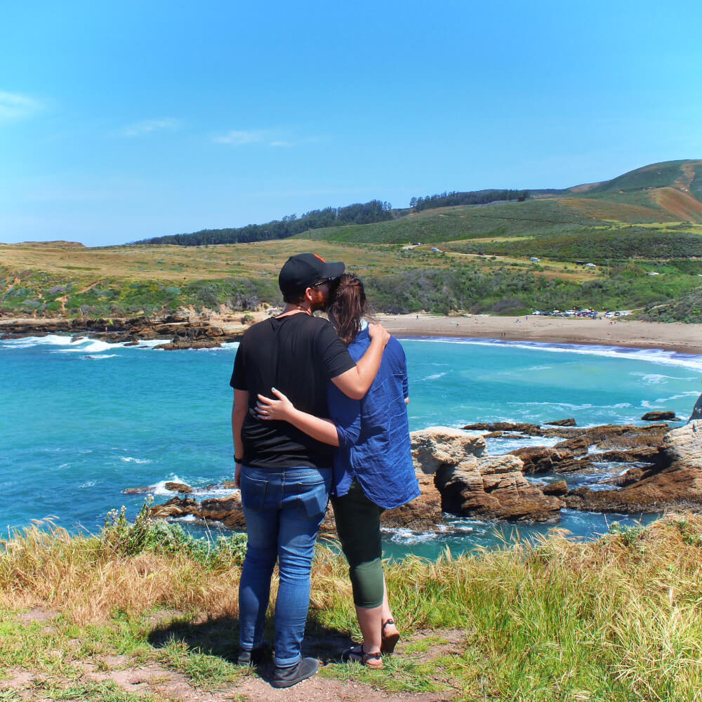 Travel couple in In Los Osos on California's Central Coast, at Montana de Oro park.