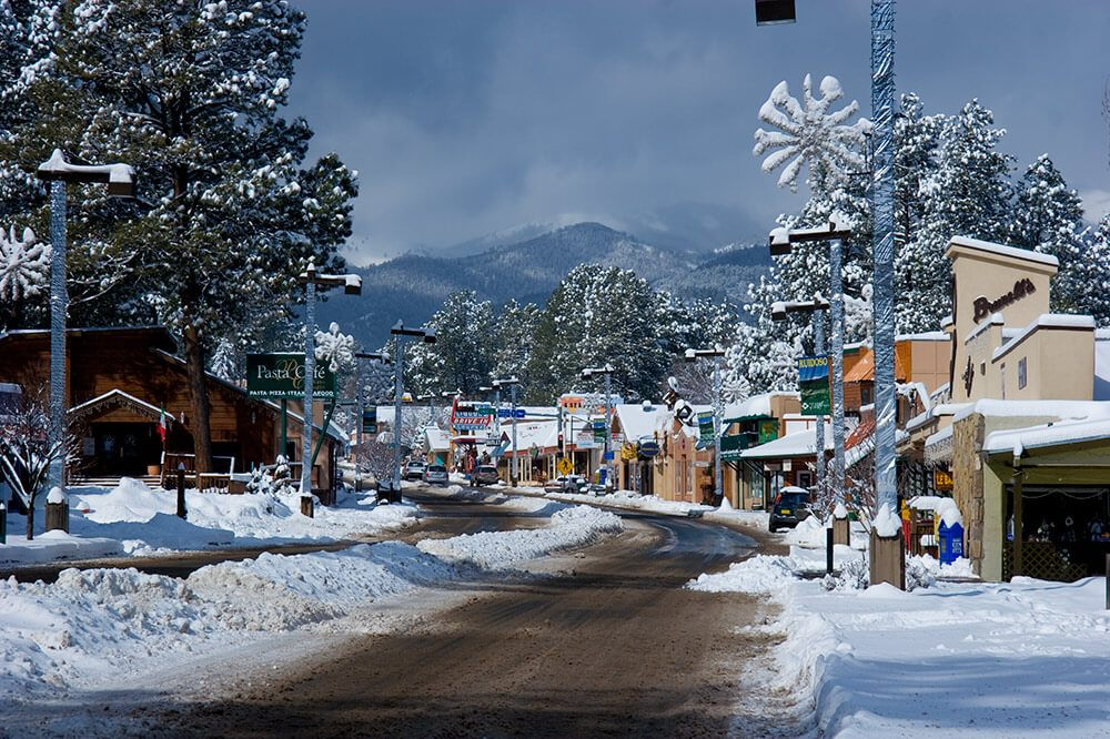 In the winter, Ruidoso, New Mexico turns into a snow-covered wonderland complete with skiing, snowboarding, snow tubing, and even horse drawn sleigh rides!