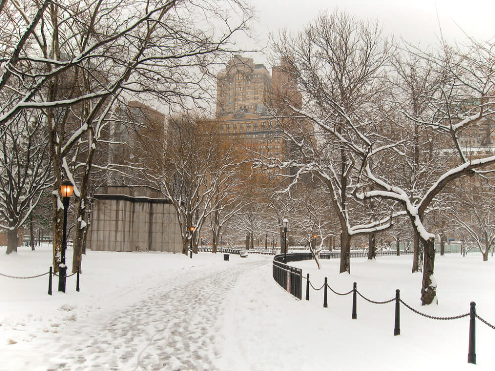 Snowy Battery Park in the chilly New York City winter. You'll walk through Battery Park on this self guided New York walking tour.
