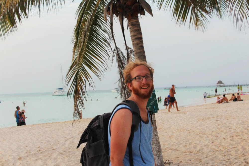 Jeremy from Practical Wanderlust on the beach in Isla Mujeres, Mexico.