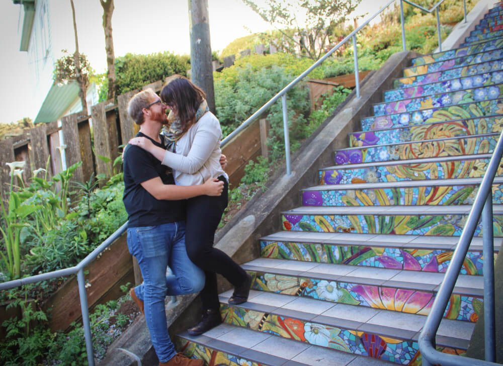 Lia & Jeremy from Practical Wanderlust being gross on the 16th Ave Tiled Steps in San Francisco, California.