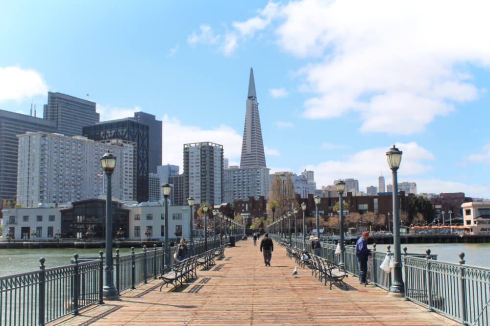 San Francisco's iconic skyline from one of my favorite piers! Psst: this is one of the stops on our self-guided walking tour.