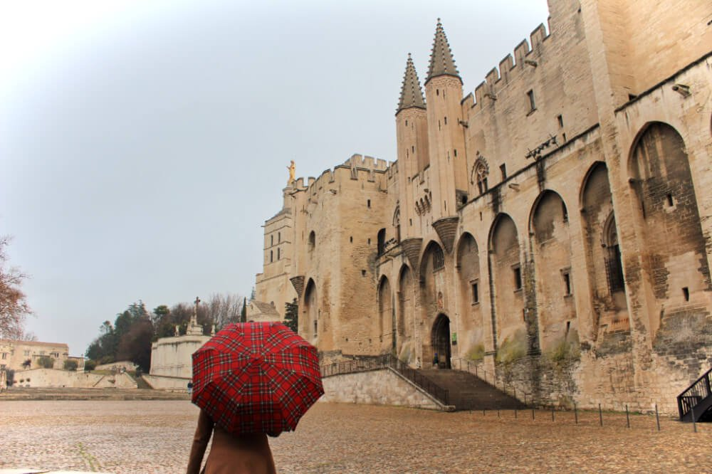 Exploring Avignon, France in the rain during our off-season France road trip.