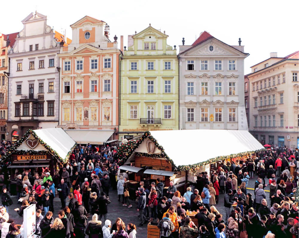 Candy colored buildings behind the Prague Christmas Markets in January.