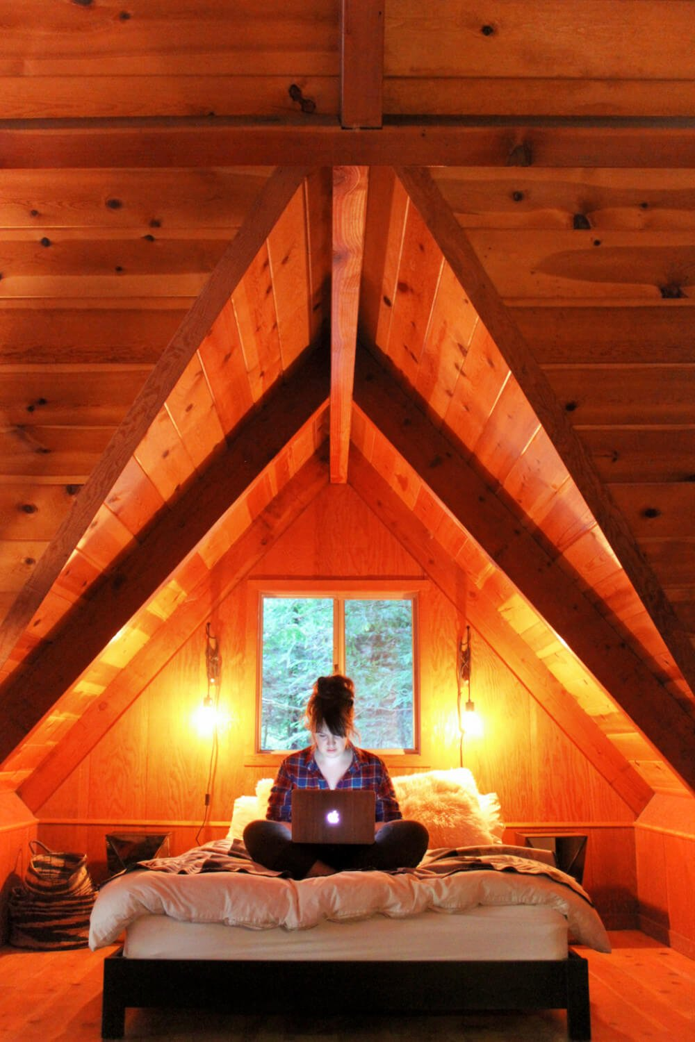 Working on the bed in our gorgeous cabin in Guerneville.
