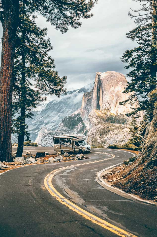 RV winding up Glacier Point Road in Yosemite National Park with a view of Half Dome