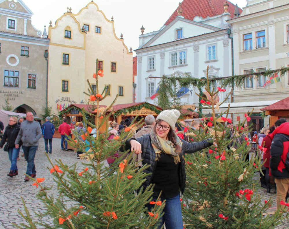 Lia hitting on Christmas Trees for some reason in Cesky Krumlov, Czechia