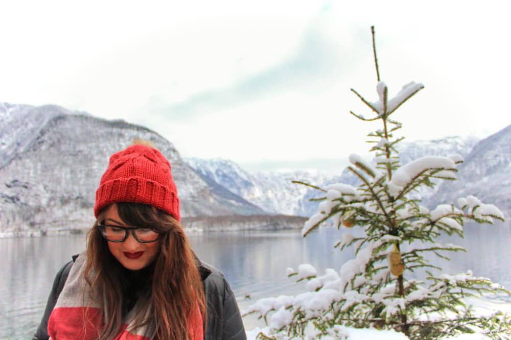 Lia in a red hat in Hallstatt, Austria in the winter.