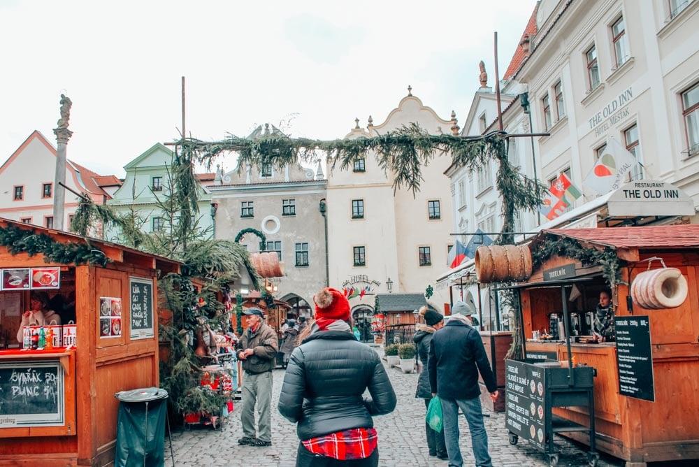 Exploring the Cesky Krumlov Christmas Market in the main square.