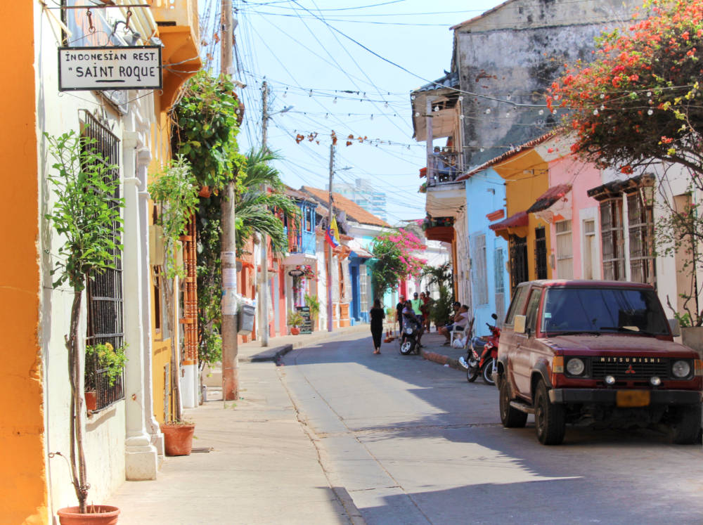 A colorful street in Getsemani, Cartagena, Colombia. There are so many fewer people in Getsemani versus the walled city, but it's just as beautiful!