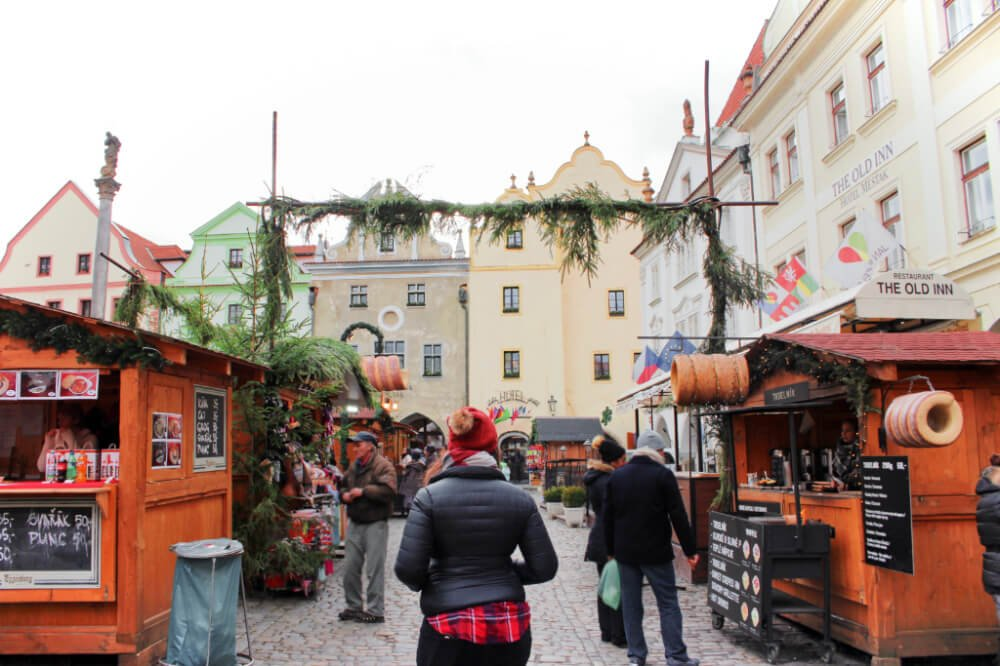 Exploring the Cesky Krumlov Christmas Market in the main square.
