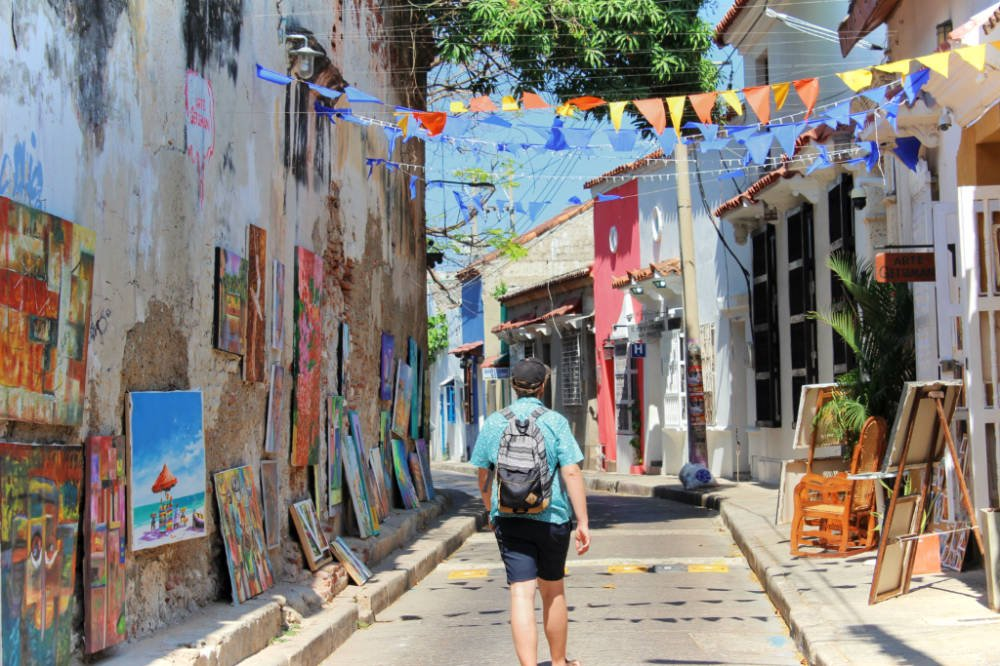 Exploring Getsemani, the colorful neighborhood in Cartagena, Colombia full of art, music, and brightly colored banners, apparently.