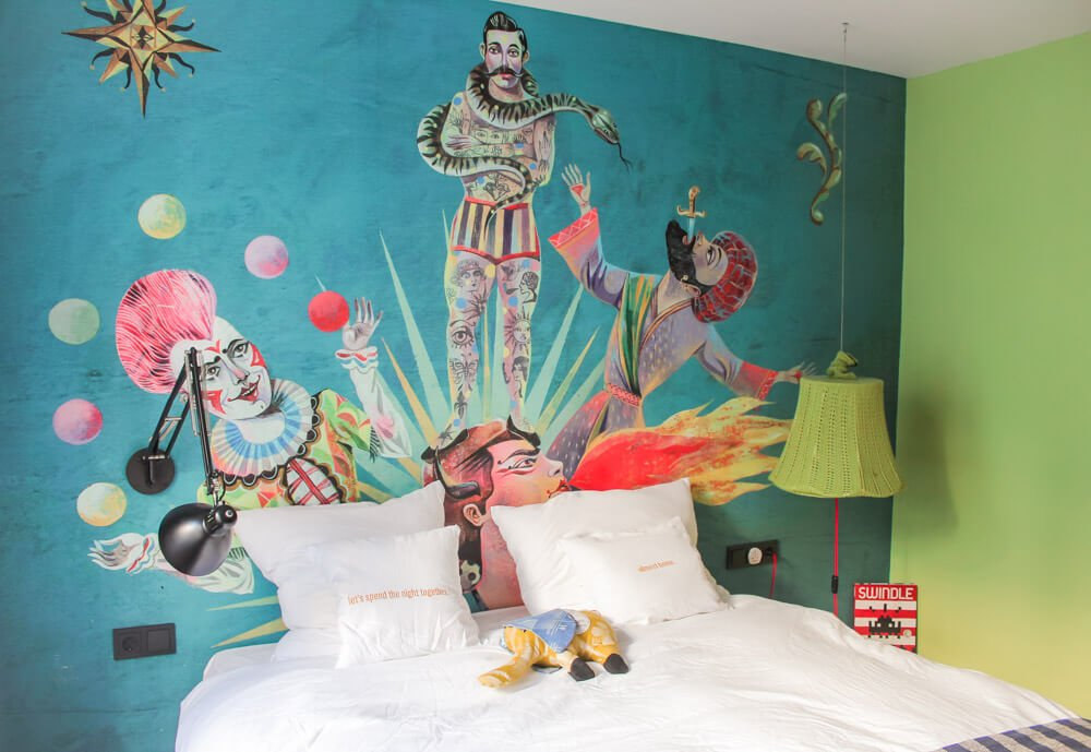 The amazing, colorful mural above our bed at 25 Hours Hotel, the best boutique hotel in Vienna!