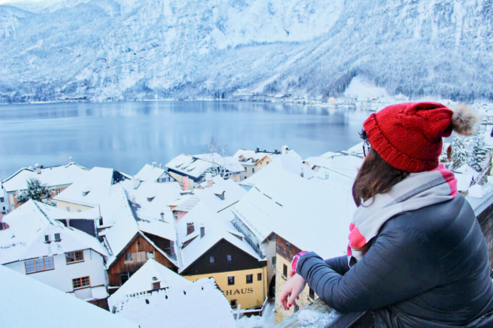 Gazing out over the snow-covered rooftops of Hallstatt, Austria.