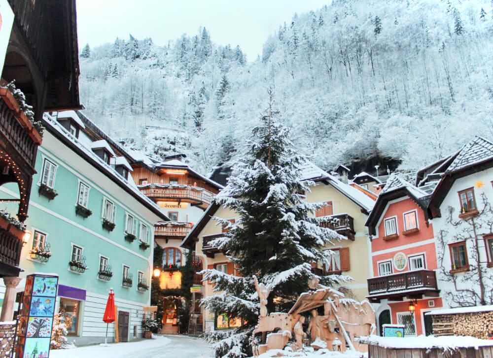 Halstatt, Austria's pastel-colored Marketplatz square covered with snow!