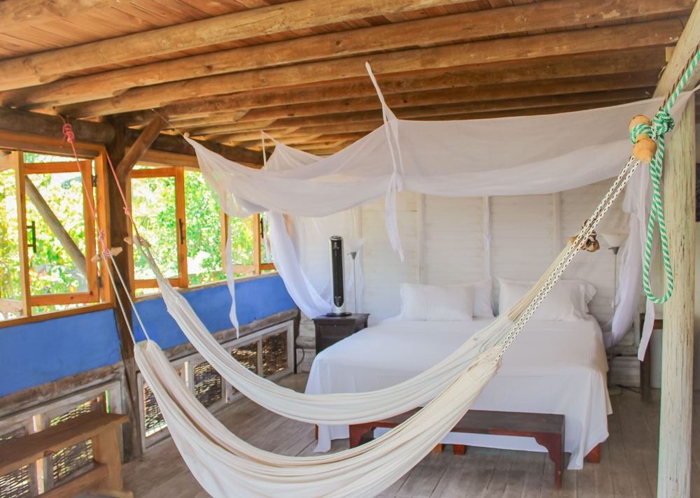 Hammocks and bed in a hotel room at Playa Manglares, Isla Baru, Cartagena, Colombia.