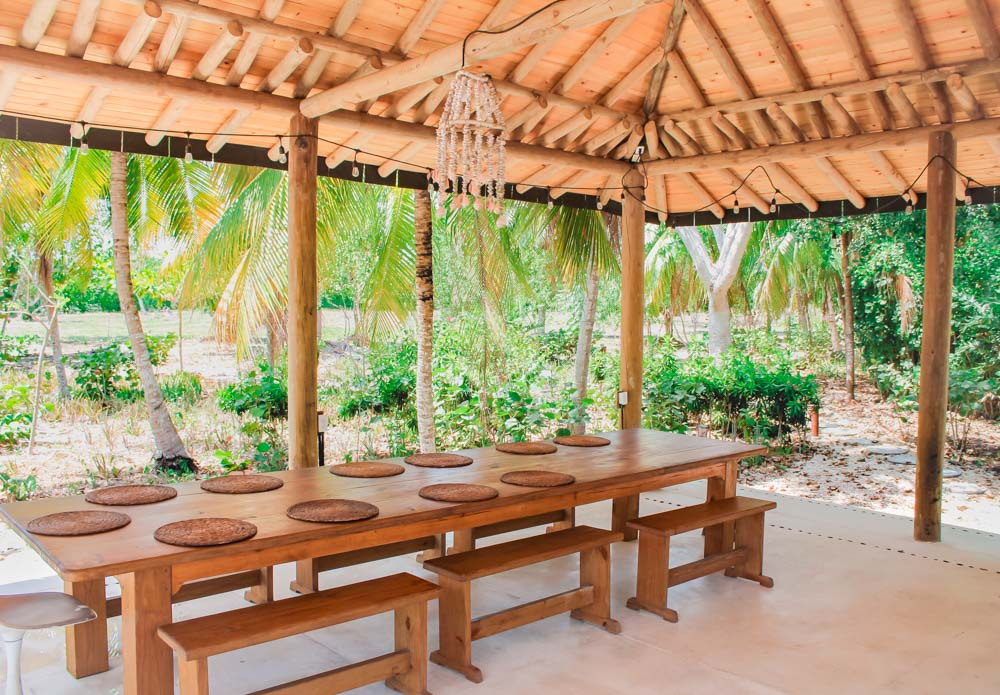 The open-air dining pavilion where family style meals are served at Playa Manglares Hotel in Isla Baru, Cartagena, Colombia.