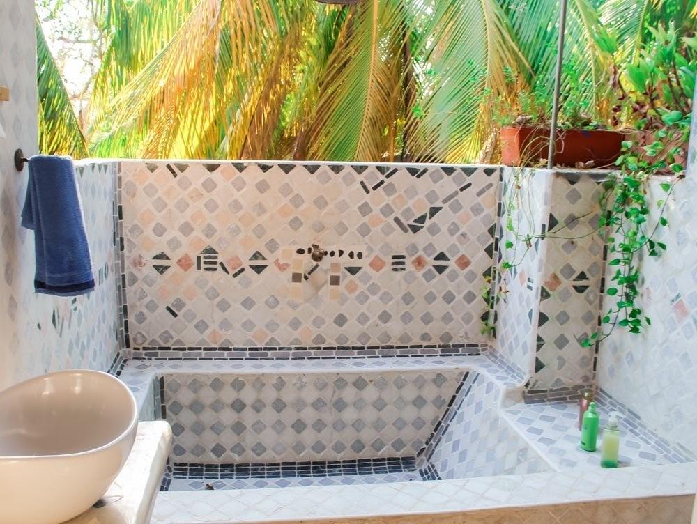 Giant tub and open-air shower at Playa Manglares, Isla Baru, Cartagena Colombia.