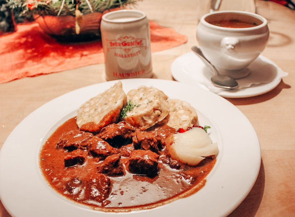 The food at our accomodation, the 700-year-old Brau-Gasthof (brewery guesthouse), was some of the best we tried in Austria! Pictured here: goulash with dumplings, clear broth soup, and beer (of course).