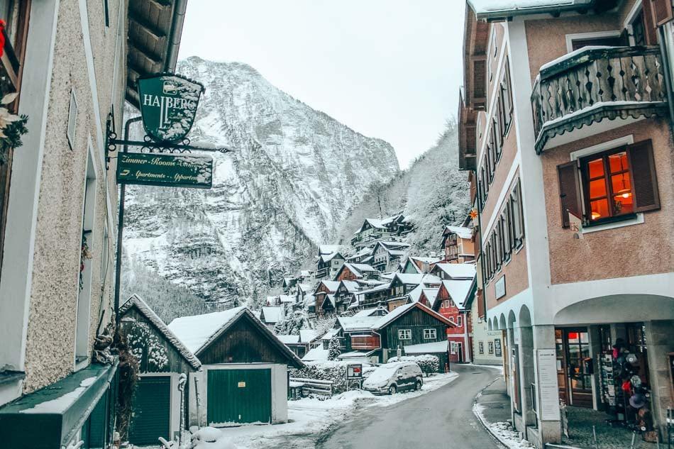 A quiet street view of Hallstatt, Austria in the snow in winter.