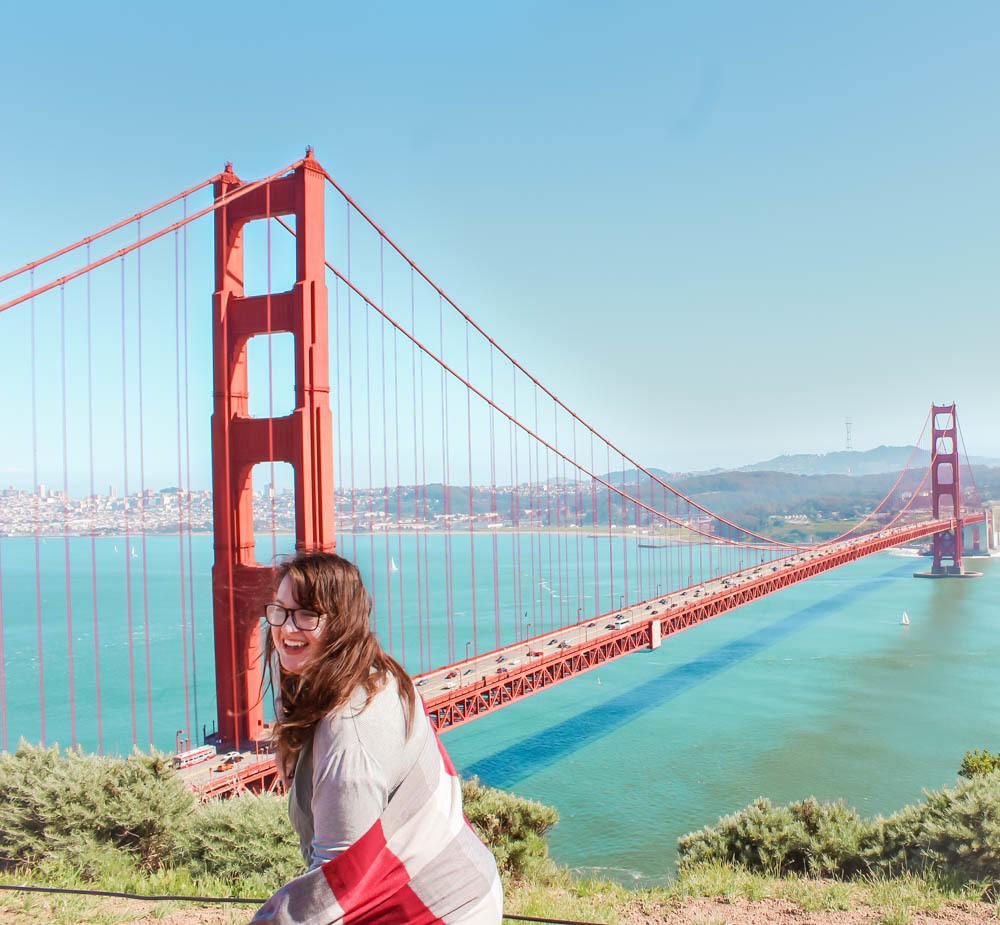 Lia in San Francisco, California in front of the Golden Gate Bridge.