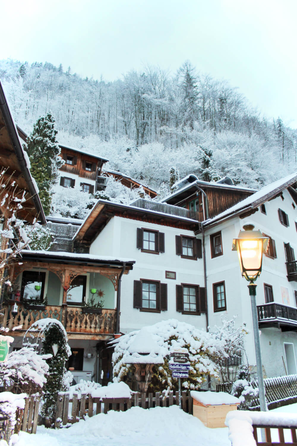 Snowy houses freshly covered in snow on a quiet morning in Hallstatt, Austria in the winter!
