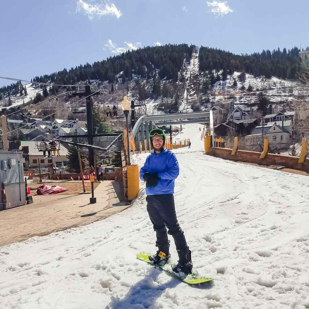 Snowboarding into town in Park City, Utah.