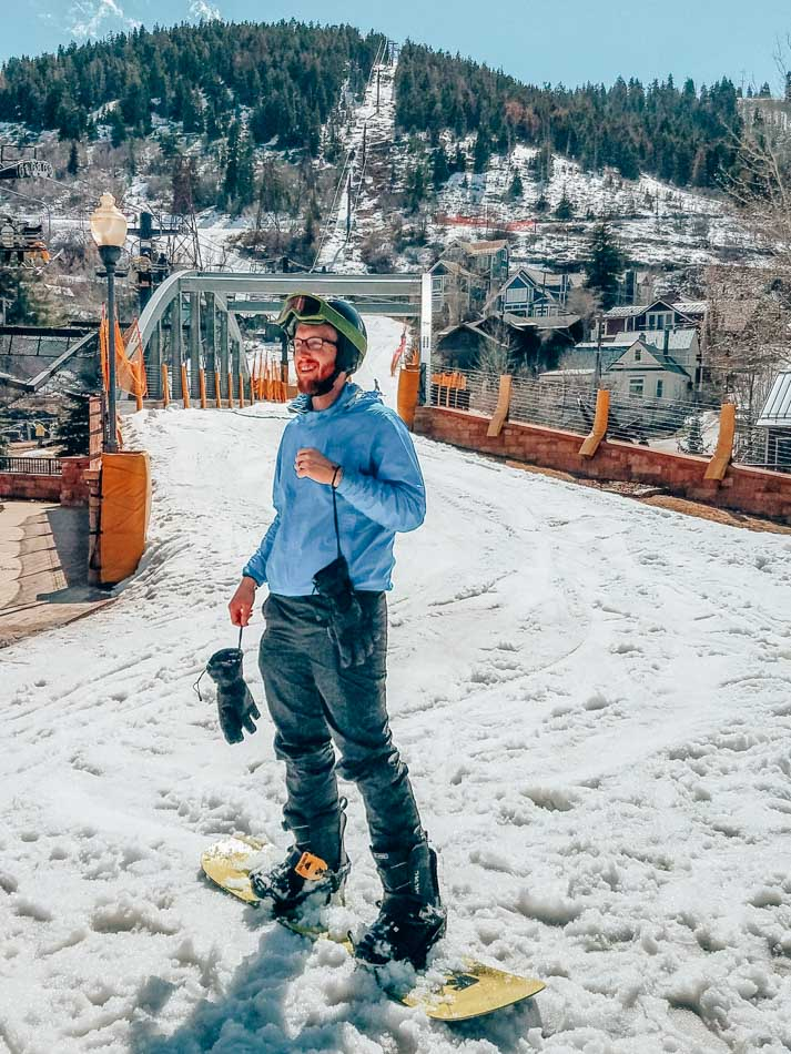 Snowboarding into town on the Town Run in Park City, Utah! Snowboarding is one of the best things to do in Park City.