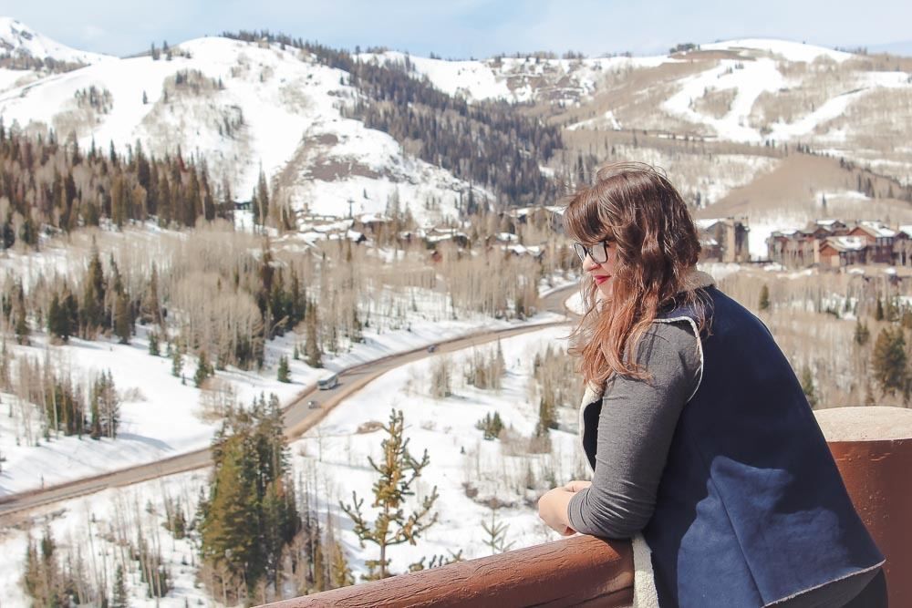 Lia looking out over Deer Valley Mountain Resort from Stein Eriksen lodge in Park City Utah.