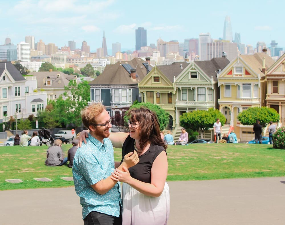 Lia and Jeremy laughing in Alamo Square, San Francisco, California.