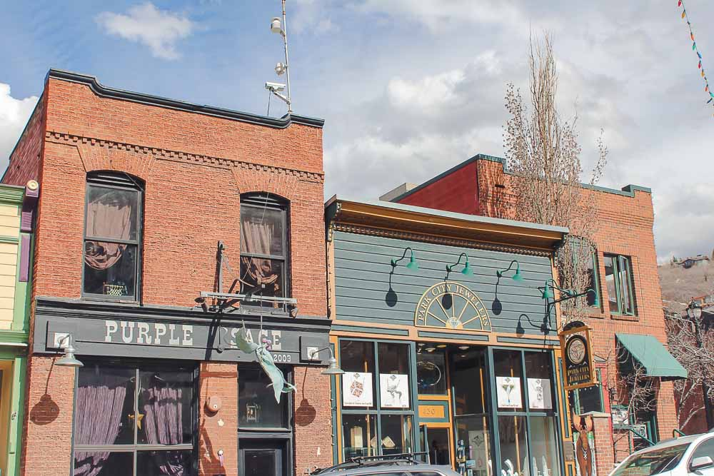 Downtown Park City, Utah is comprised of a long main street lined with western-style shops and adorable facades.