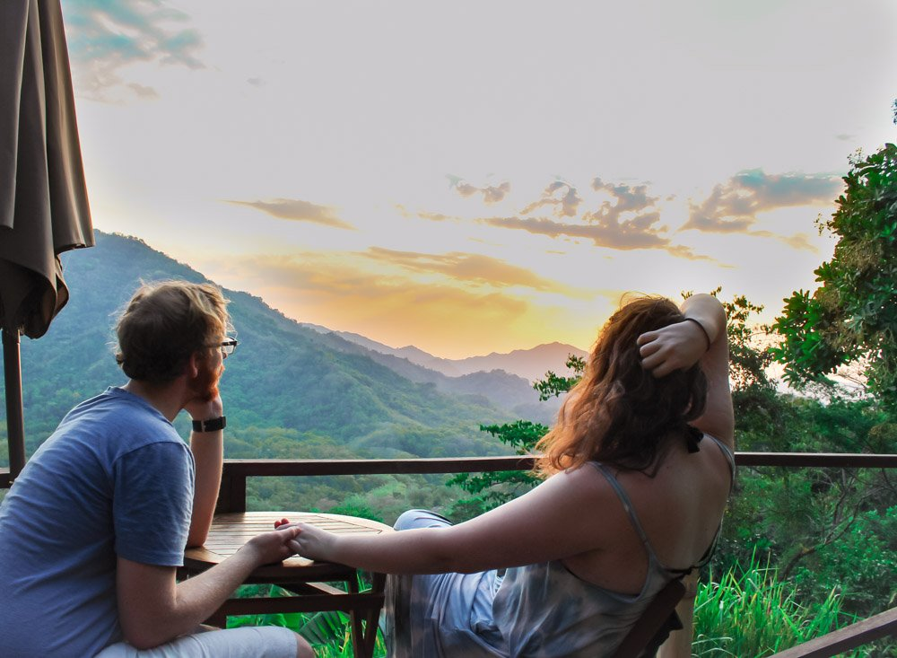 Lia and Jeremy watching the sun setting over Minca, Colombia.