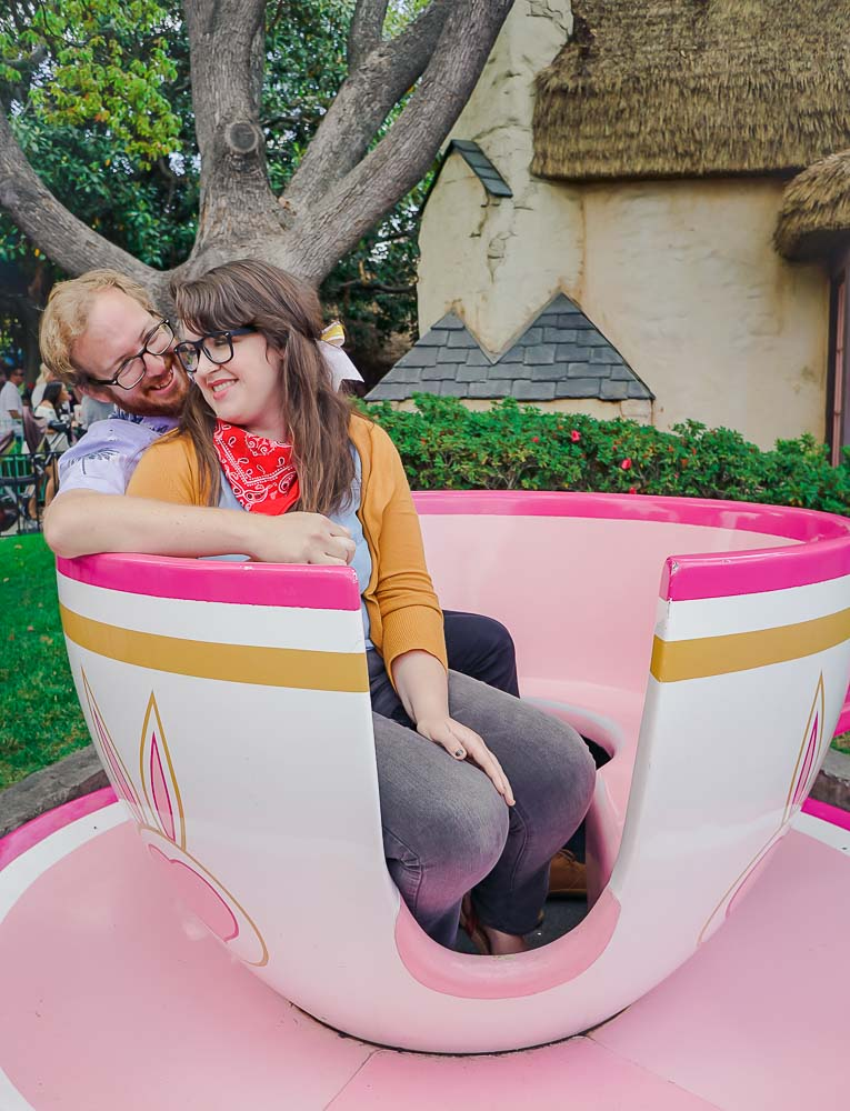 This pink teacup outside of the Mad Teacups is the perfect spot for a cuddly couple's photo op in Disneyland, California.