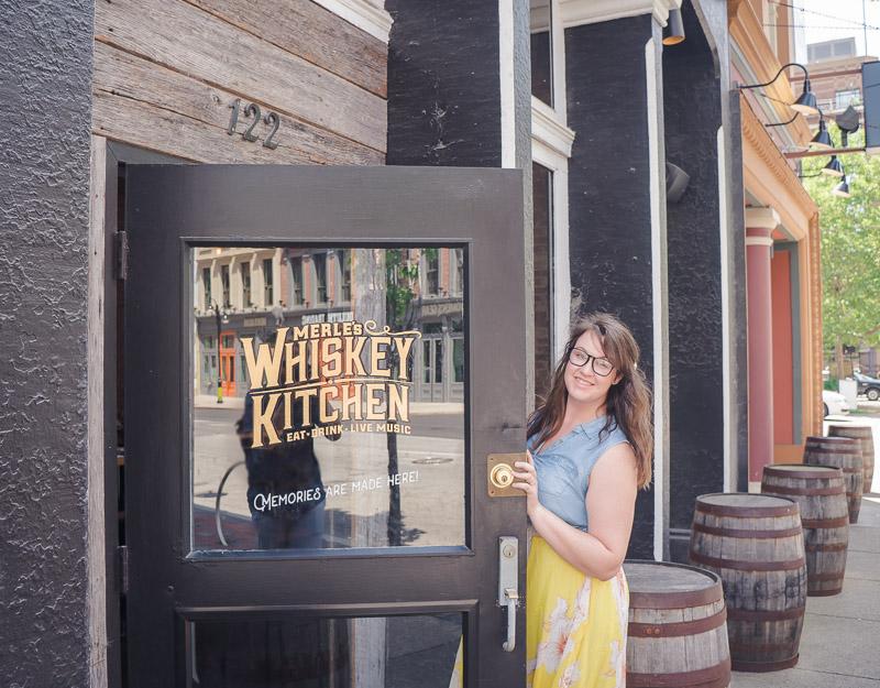 Lia walking into Merle's Whiskey Kitchen in Louisville, Kentucky.