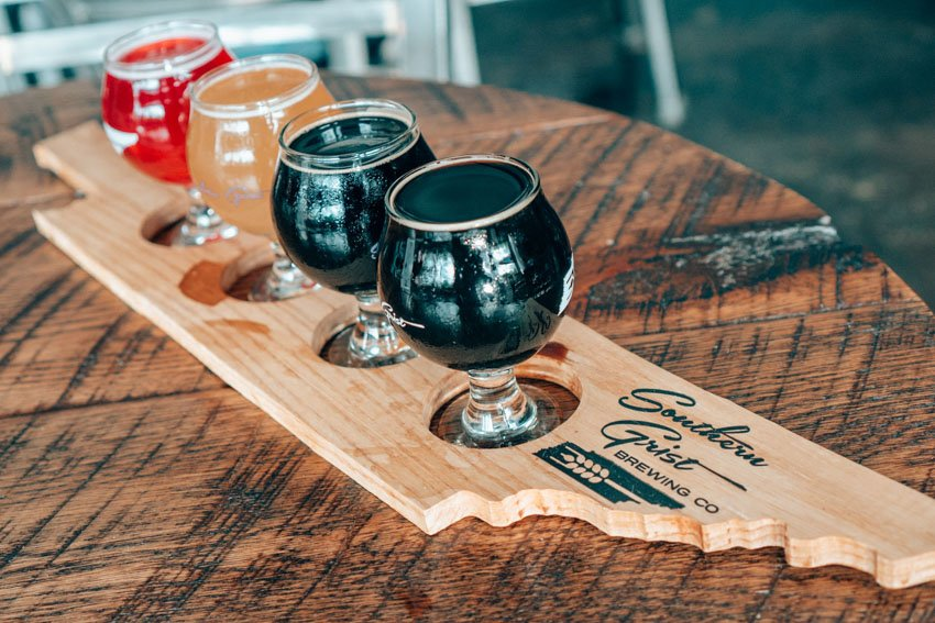 Don't forget to try some local beer while you're in town. Southern Grist is a fantastic local brewery with a ton of selection. You can try their Strawberry Ginger beer at The Pharmacy Burger Parlor!