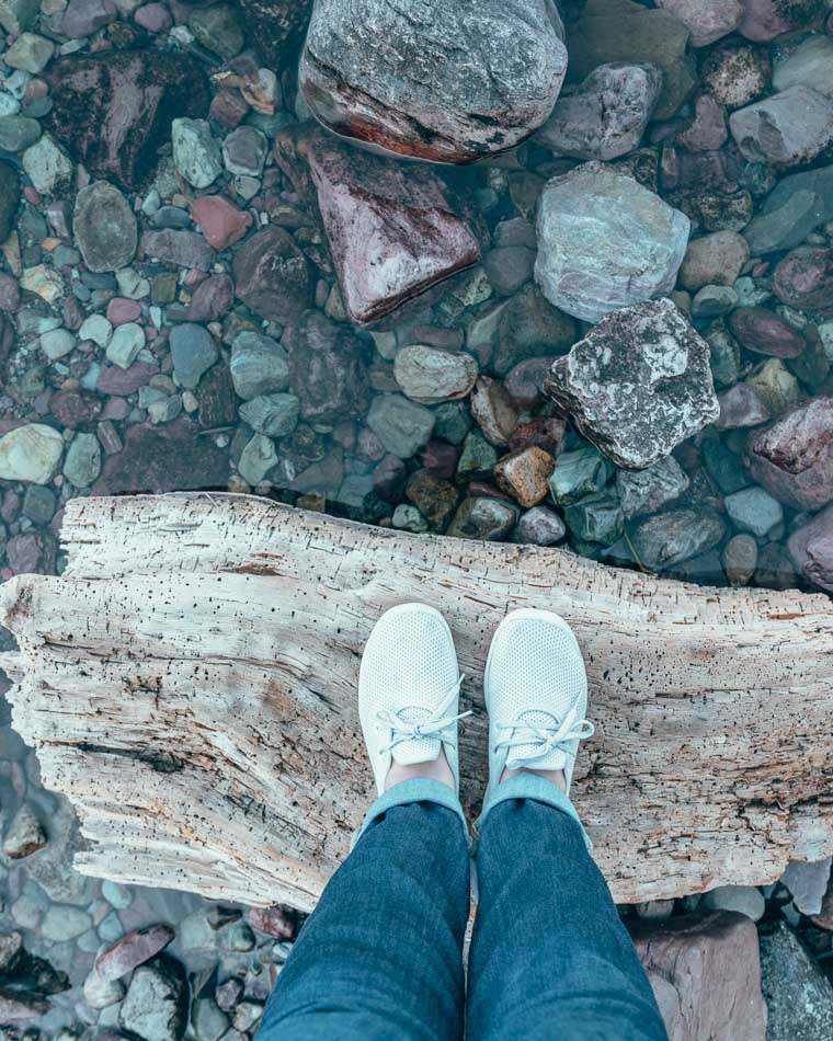 Admiring the colorful rocks in Glacier National Park in my gorgeous, cozy AllBirds Tree Skippers!