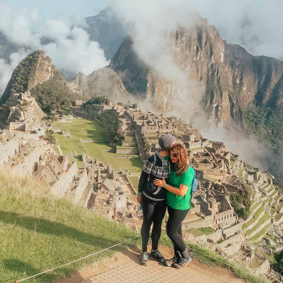 Couple wearing matching Altra Lone Peak trail runners at Machu Picchu.