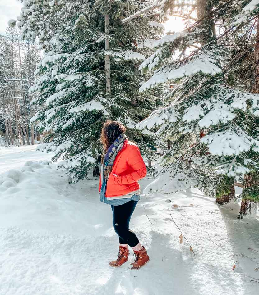 Lia wearing Vivobarefoot Tracker Boots in the snow in Lake Tahoe.