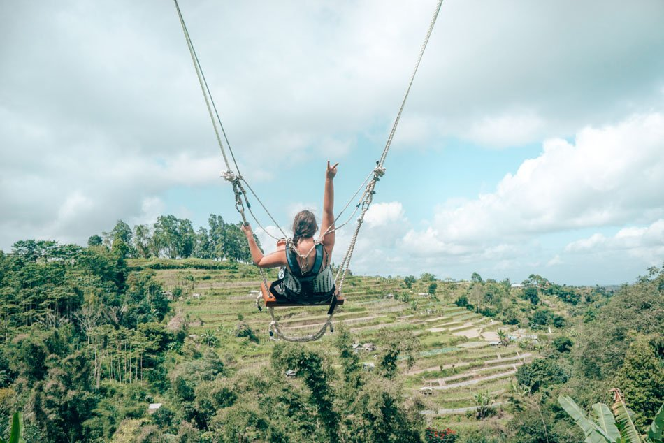 Swinging above the rice terraces in Bali, Indonesia.