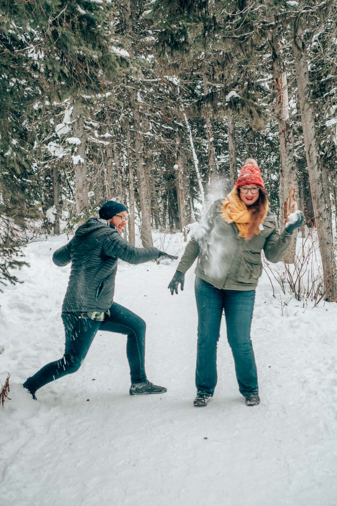 Jeremy and Lia snowball fight in Banff, Canada in the winter. fight