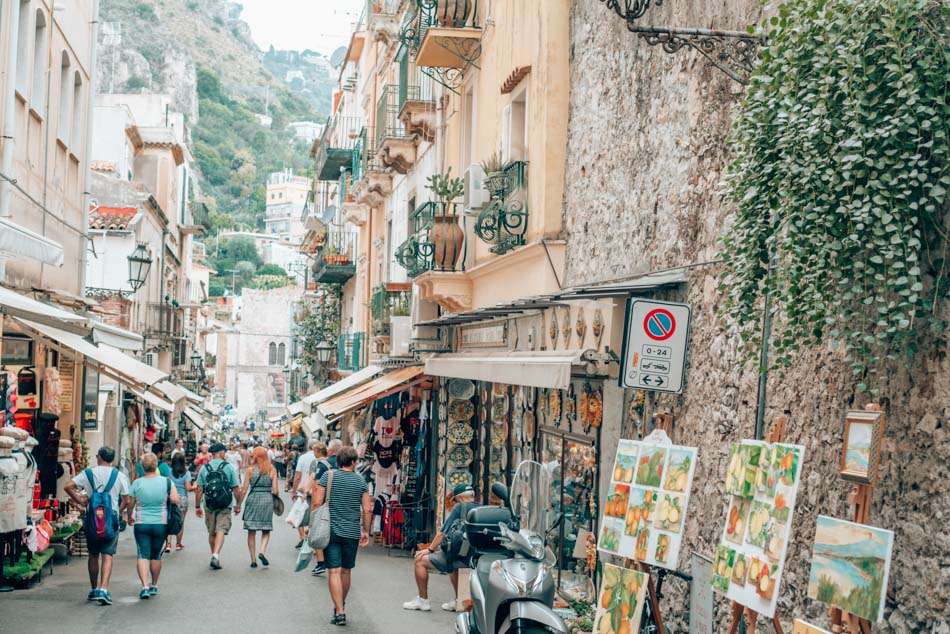 Strolling around picturesque Taormina, Sicily, a UNESCO World Heritage site perched on top of a hill.