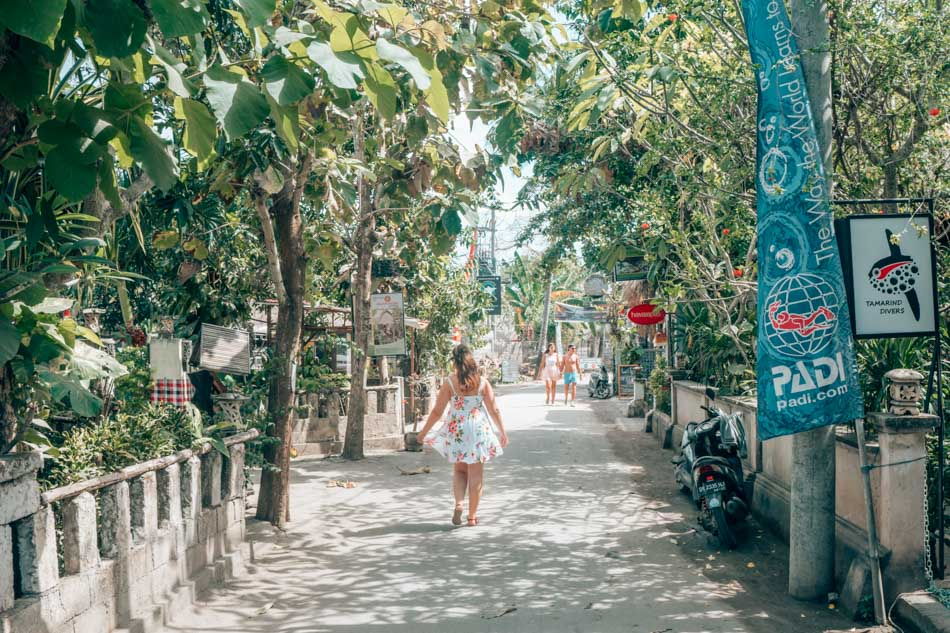 Exploring stunning Nusa Lembongan by scooter is a budget-friendly way to spend a day in Bali, Indonesia.