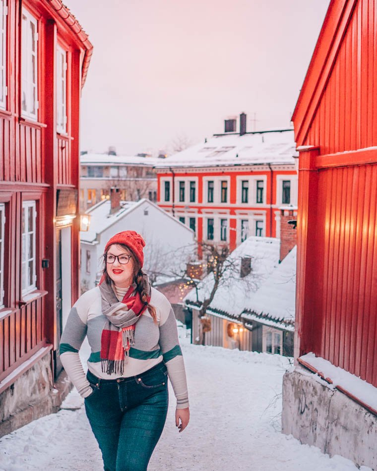 Matching a bright red alley in Oslo, Norway in the winter.