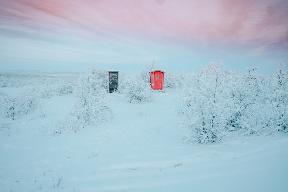 Outhouses in the snow in the Arctic Tundra, Finnmark, Norway.